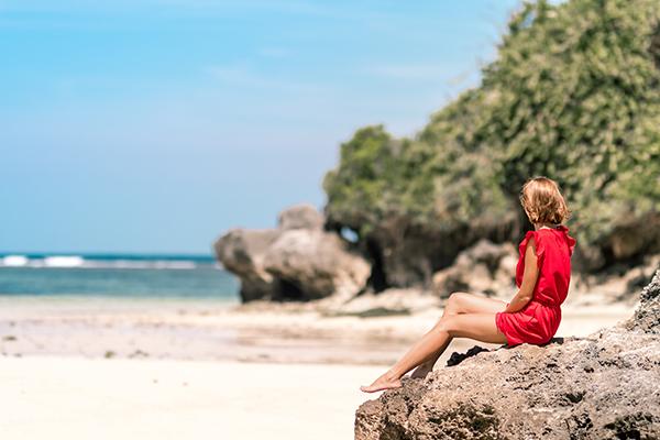 woman in red dress on Hermanus beach